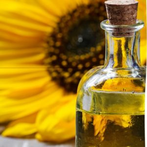 auringonkukka ja öljypullo